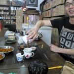 Feng pours the tea.